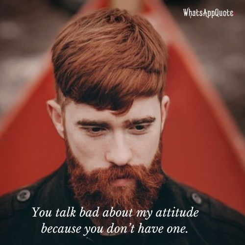 one handsome serious redhead man with long red beard in coat